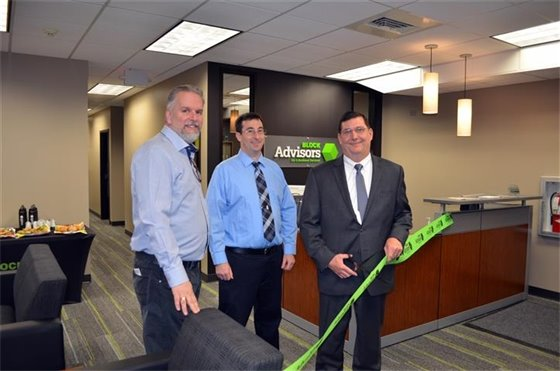 Ribbon-cutting marks opening of Block Advisors on Elm St.